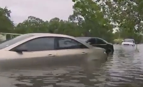 car submerged in flood water disaster