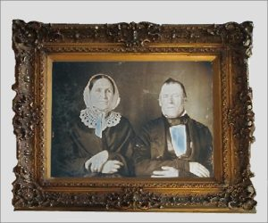 2 wealthy people in a old picture frame