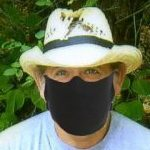 author with a coronavirus on mask