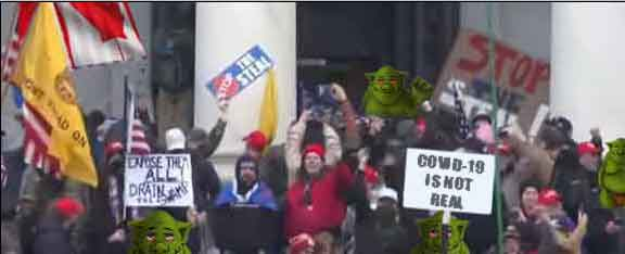protesters with a green trolls